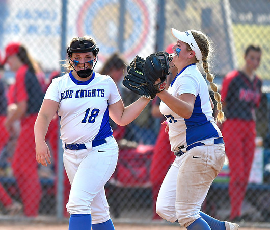6/8/2019 Mike Orazzi | Staff Southington's Julia Panarella (18) and Abigail Lamson (17) during Saturday's Class LL Softball Final at DeLuca Field in Stratford. ?