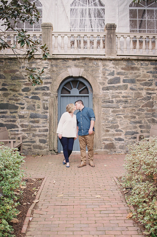 Lauren and Ty's Old Town Alexandria engagement photos included a stop in a garden to shoot in front of a blue door.