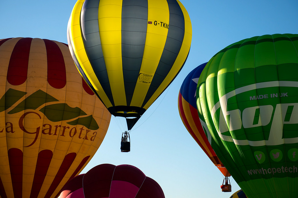 . Hot air balloons take to the skies as they launch on July 10, 2014 in Igualada, Spain. The early morning flight of over 30 balloons was shorter than expected due to windy weather.  (Photo by David Ramos/Getty Images)