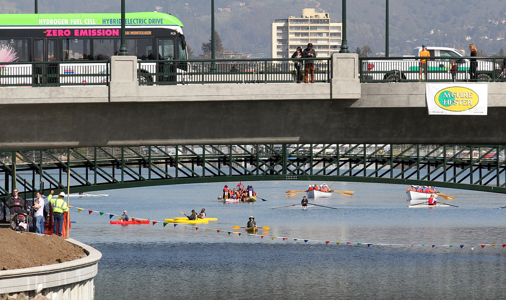 . Kayakers, whaleboats, and dragon boats wait to enter the channel at the start of the celebration of the re-opening of a 750-foot section of the  Lake Merritt Channel in Oakland, Calif., on Friday, Feb. 22, 2013. The new 100-foot-wide free flowing tidal channel, for the first time since 1869, allows boats to travel from the Lake Merritt Channel to Lake Merritt . This is the first of a series of projects that will eventually connect Lake Merritt to the Oakland Estuary. (Laura A. Oda/Staff)