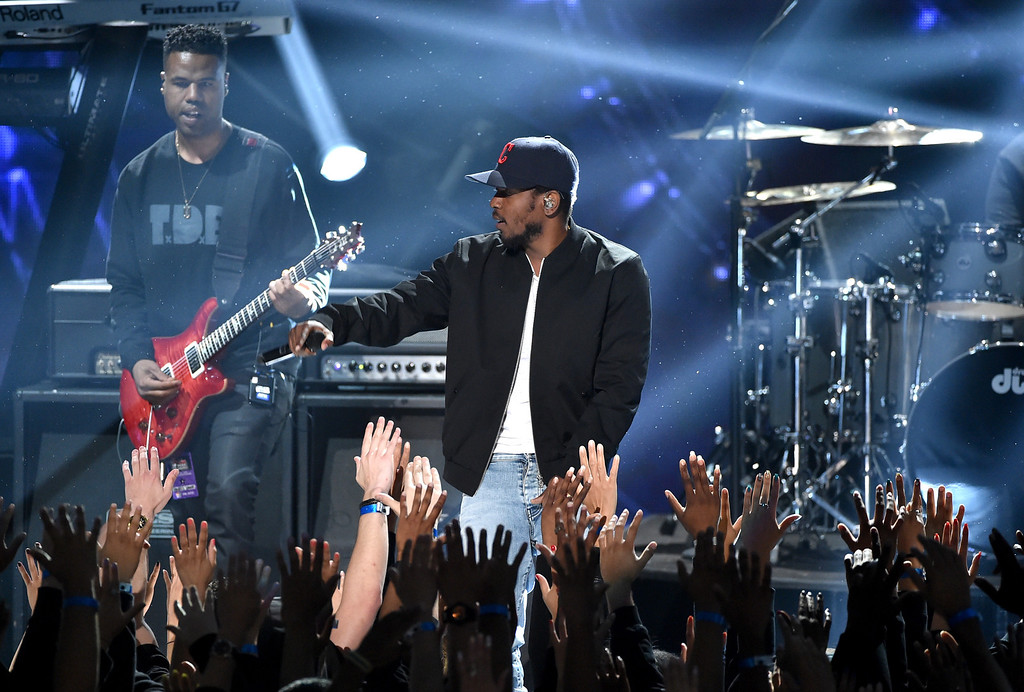. LOS ANGELES, CA - MAY 01:  Rapper Kendrick Lamar performs onstage during the 2014 iHeartRadio Music Awards held at The Shrine Auditorium on May 1, 2014 in Los Angeles, California. iHeartRadio Music Awards are being broadcast live on NBC.  (Photo by Kevin Winter/Getty Images for Clear Channel)