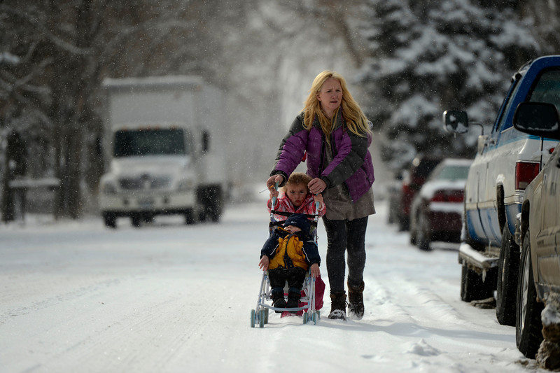 """. Meghan Lillis gets help from her daughter Cassidy 3, pushing her son Cameron 1, along Reed St. in Lakewood after an over night snow fall left 3 to 6 inches across Denver and the surrounding areas February 21, 2013. \""""We\'re going to get breakfast, then to Walmart for sleds and to the park for sledding,\"""" she said. Lakewood, Colorado. (Photo By Joe Amon/The Denver Post)"""