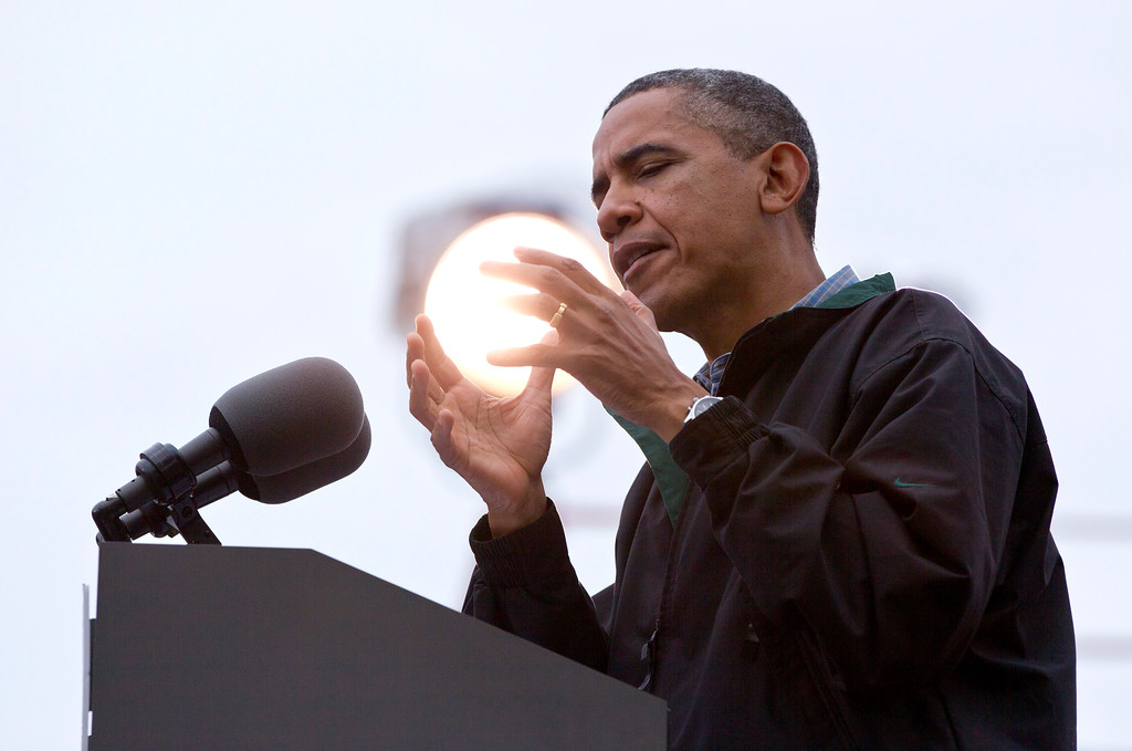 . A light shines behind President Barack Obama as he speaks during a campaign event at Bayliss Park, Monday, Aug. 13, 2012, in Council Bluffs, Iowa, during a three day campaign bus tour through Iowa. (AP Photo/Carolyn Kaster)