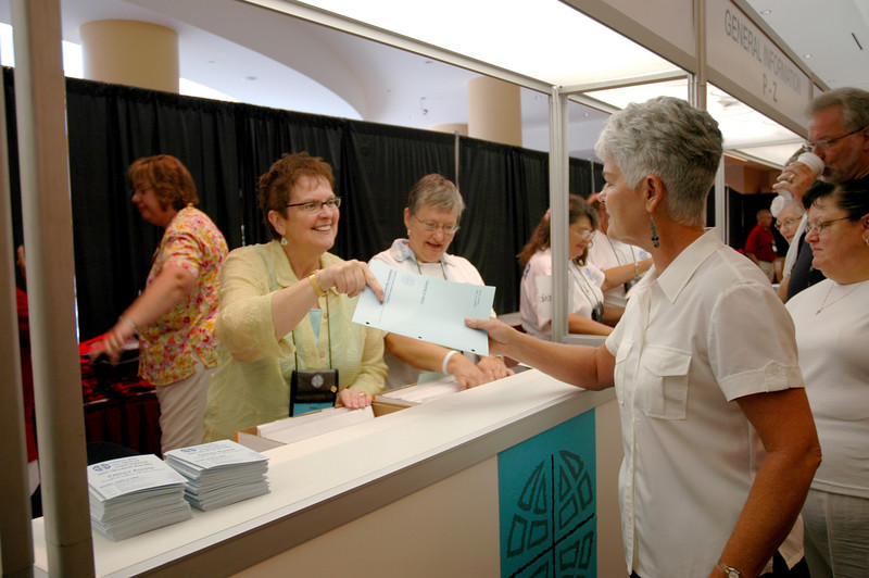 Sally Almen (left) and Ione Hanson (right) at the assembly registration desk