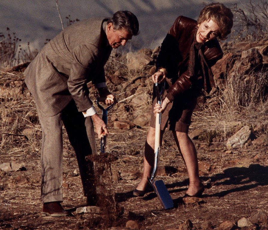 . 11/21/88--Simi Valley:  President Ronald Reagan shovels dirt while Nancy struggles to break the surface during a ground breaking ceremony for the new Reagan Library in Simi Valley. (John McCoy/Los Angeles Daily News)