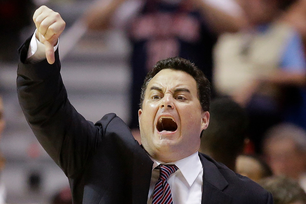 . Arizona head coach Sean Miller gestures to his team as they play Gonzaga during the first half of a third-round game in the NCAA college basketball tournament Sunday, March 23, 2014, in San Diego. (AP Photo/Lenny Ignelzi)
