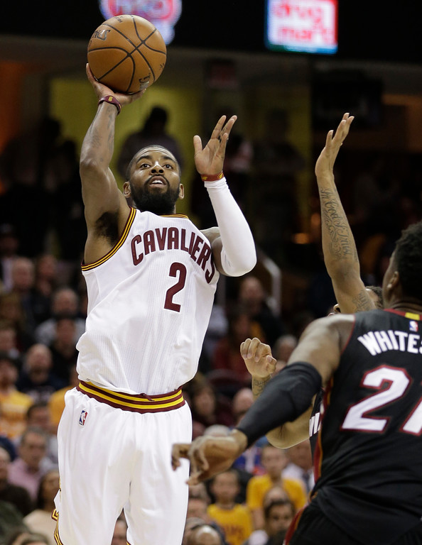 . Cleveland Cavaliers\' Kyrie Irving (2) shoots against the Miami Heat in the first half of an NBA basketball game, Monday, March 6, 2017, in Cleveland. (AP Photo/Tony Dejak)