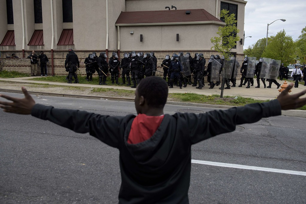 . Baltimore police officers form a line in front of protesters in the streets near Mondawmin Mall April 27, 2015 in Baltimore, Maryland. Violent street clashes erupted in Baltimore on Monday after friends and family gathered for the funeral of Freddie Gray, a 25-year-old black man whose death in custody triggered a fresh wave of protests over US police tactics. Police said at least seven officers were injured -- one of them was unresponsive -- as youths hurled bricks and bottles and destroyed at least one police vehicle in the vicinity of the shopping mall not far from the church where the funeral took place.  BRENDAN SMIALOWSKI/AFP/Getty Images