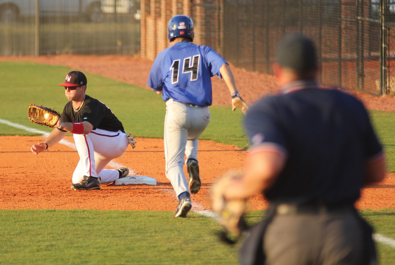 First Baseman Dusty Quattlebaum records an out for the Gardner-Webb squad on March 18th, 2011.