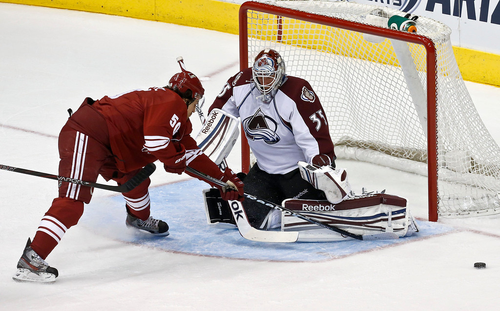 . Colorado Avalanche\'s Jean-Sebastien Giguere (35) makes a save on a shot by Phoenix Coyotes\' Antoine Vermette (50) during the first period in an NHL hockey game, on Friday, April 26, 2013, in Glendale, Ariz. (AP Photo/Ross D. Franklin)