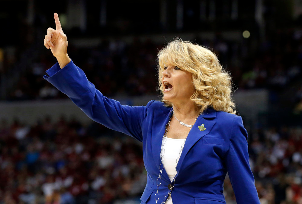 Description of . Oklahoma head coach Sherri Coale gestures during the first half of a regional semifinal game against Tennessee in the women's NCAA college basketball tournament in Oklahoma City, Sunday, March 31, 2013. (AP Photo/Sue Ogrocki)