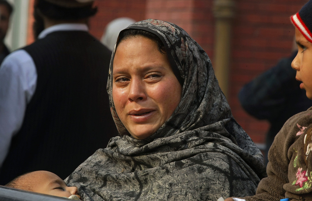 . A Pakistani woman weeps as she waits at a hospital, where victims of a Taliban attack are being treated in Peshawar, Pakistan,Tuesday, Dec. 16, 2014. Taliban gunmen stormed a military-run school in the northwestern Pakistani city of Peshawar on Tuesday, killing and wounding scores, officials said, in the highest-profile militant attack to hit the troubled region in months.(AP Photo/Mohammad Sajjad) (AP Photo/Mohammad Sajjad)