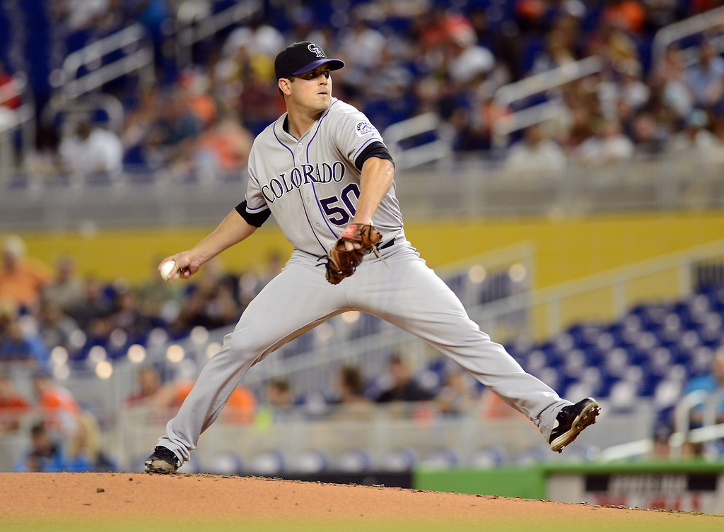 . MIAMI, FL - AUGUST 24:  Pitcher Jeff Manship #50 of the Colorado Rockies throws against the Miami Marlins at Marlins Park on August 24, 2013 in Miami, Florida.  (Photo by Jason Arnold/Getty Images)
