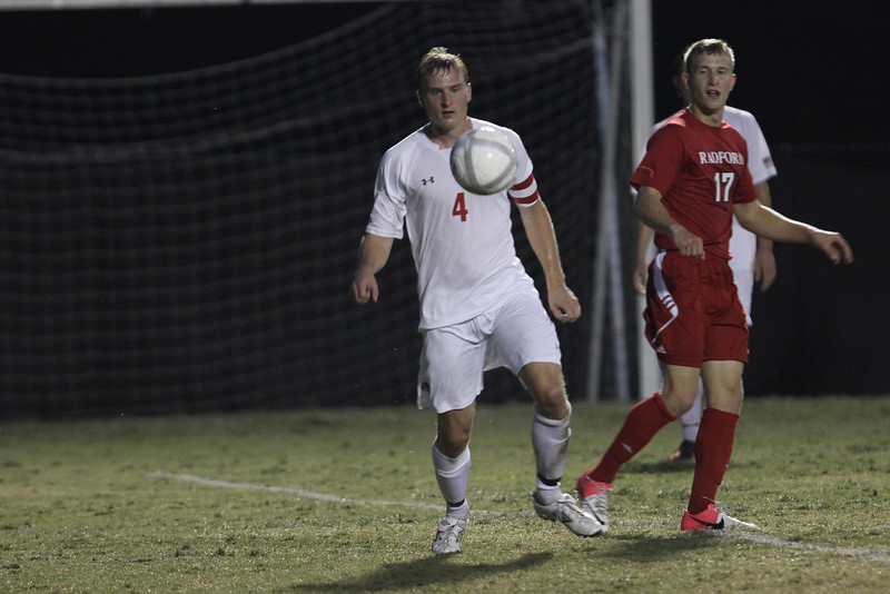 Jon Reinhardsen (4) keeps his eyes on the ball