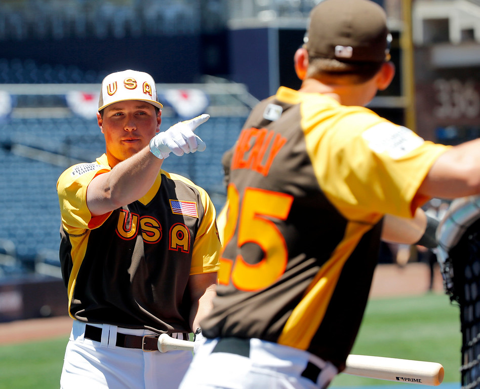 . U.S. team\'s Hunter Renfroe, of the San Diego Padres, points during team workouts prior to the All-Star Futures baseball game against the World team, Sunday, July 10, 2016, in San Diego. (AP Photo/Lenny Ignelzi)