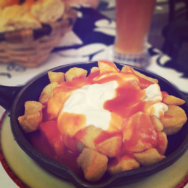 Patatas_bravas_is_a_very_typical_dish_in_Spain_where_potatoes_are_usually_covered_in_a_spicy_tomato_cream_sauce._Generally_I_don_t_like_it_but_at_this_tacky_pub_in_Longrono__with_fried_and_microwaved_food_somehow_made_this_a_guilty_pleasure..jpg