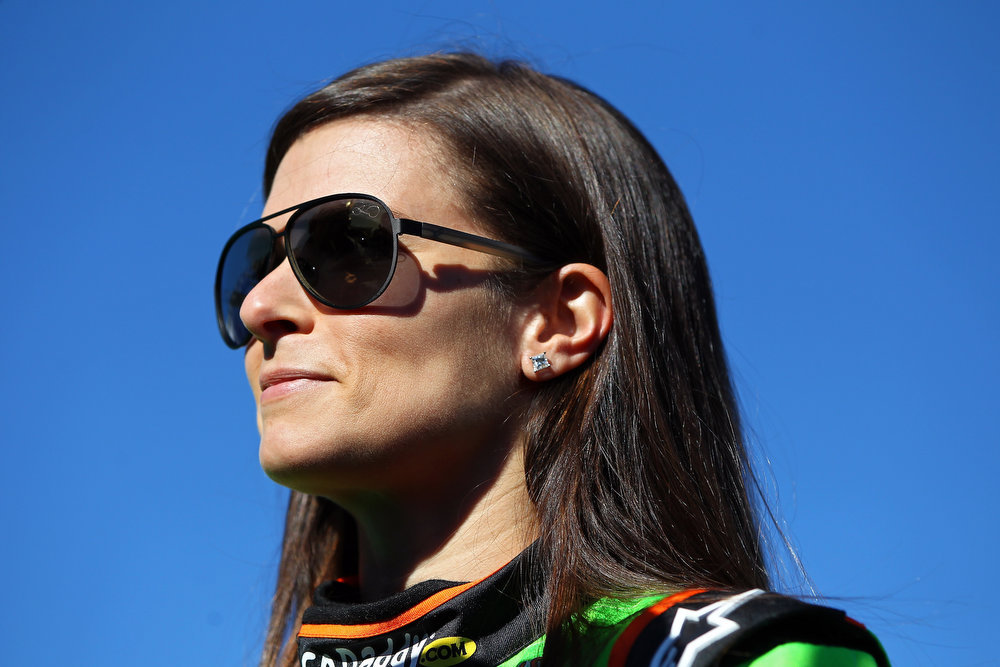 Description of . Danica Patrick, driver of the #10 GoDaddy.com Chevrolet, looks on after qualifying for the NASCAR Sprint Cup Series Daytona 500 at Daytona International Speedway on February 17, 2013 in Daytona Beach, Florida.  (Photo by Jonathan Ferrey/Getty Images)