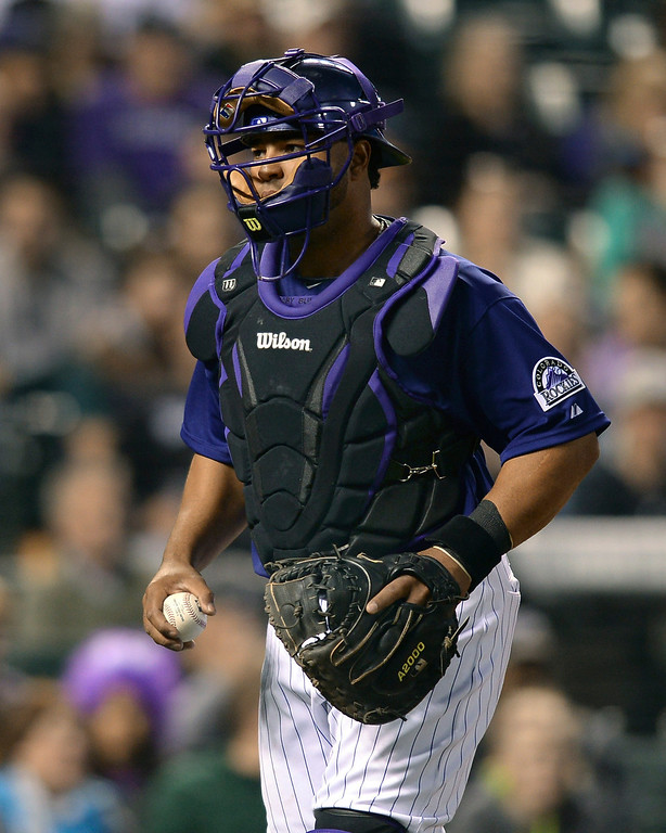 . Colorado catcher Wilin Rosario got the start behind the plate Tuesday night. The Chicago White Sox clobbered the Colorado Rockies 15-3 Tuesday night, April 8, 2014 at Coors Field in Denver.  (Photo by Karl Gehring/The Denver Post)
