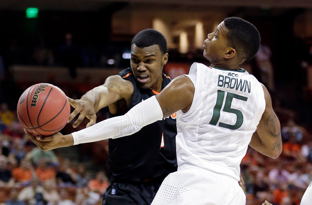 . Miami\'s Rion Brown (15) and Pacific\'s Khalil Kelley go after a rebound during the first half of a second-round game of the NCAA college basketball tournament Friday, March 22, 2013, in Austin, Texas.  (AP Photo/Eric Gay)