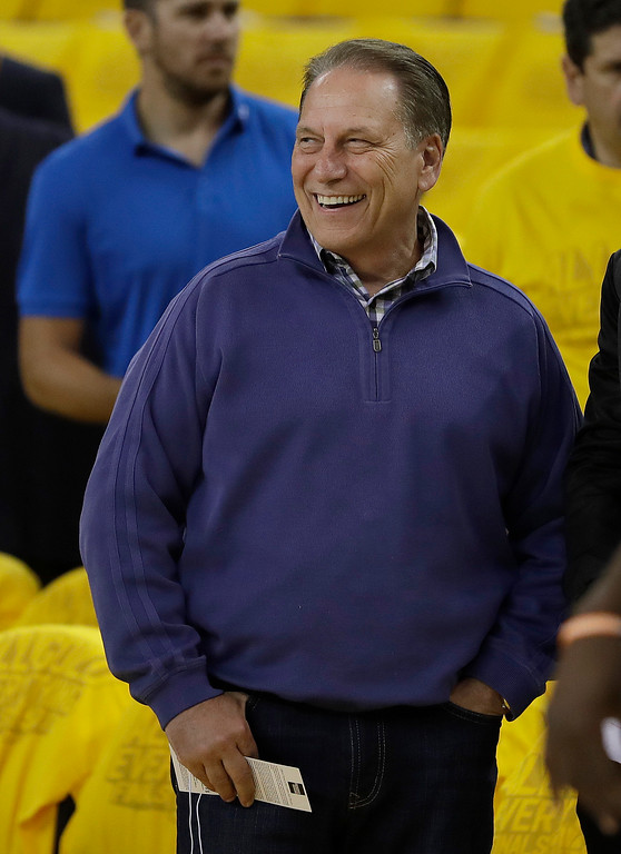 . Michigan State head coach Tom Izzo watches warm ups before Game 1 of basketball\'s NBA Finals between the Golden State Warriors and the Cleveland Cavaliers in Oakland, Calif., Thursday, June 1, 2017. (AP Photo/Marcio Jose Sanchez)