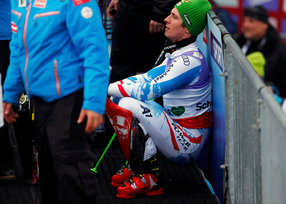 Description of . First placed Marcel Hirscher of Austria rests after the men's Slalom race at the World Alpine Skiing Championships in Schladming February 17, 2013.   REUTERS/Dominic Ebenbichler