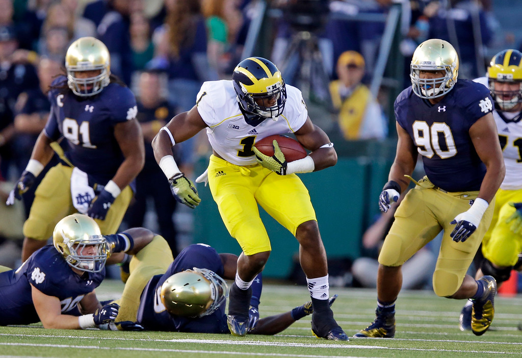 . Michigan wide receiver Devin Funchess cuts through the Notre Dame defense after making a catch during the first half of an NCAA college football game in South Bend, Ind., Saturday, Sept. 6, 2014. (AP Photo/Michael Conroy)