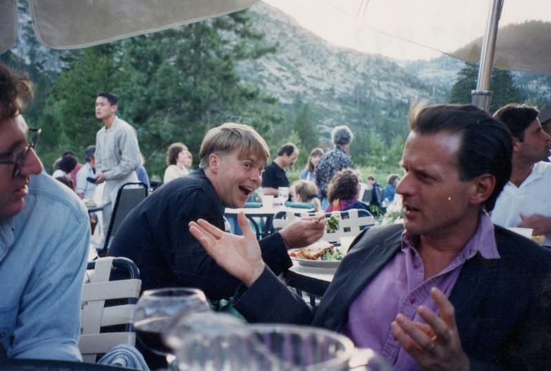 Mark Childress, Louis B. Jones. Jay Gummerman (left). At dinner.