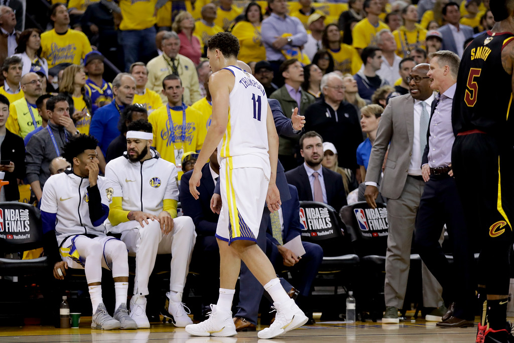 . Golden State Warriors guard Klay Thompson is helped off the floor during the first half of Game 1 of basketball\'s NBA Finals between the Warriors and the Cleveland Cavaliers in Oakland, Calif., Thursday, May 31, 2018. (AP Photo/Marcio Jose Sanchez)