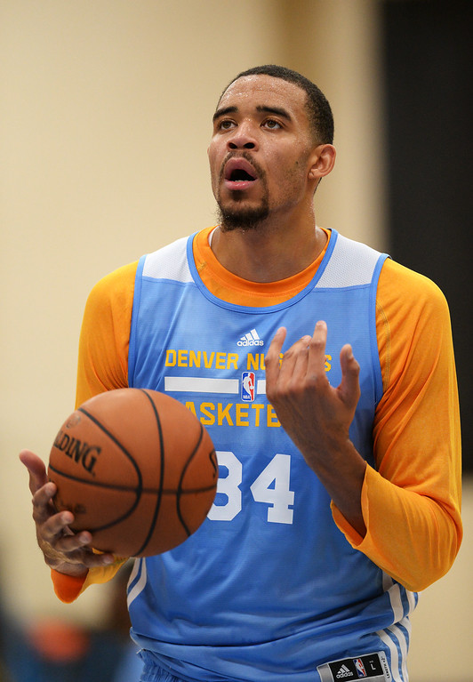 . JaVale McGee of Denver Nuggets (34) is in the team practice. The Denver Nuggets take the court for their first official practice under new coach Brian Shaw at Pepsi Center. Denver, Colorado. October 1, 2013. (Photo by Hyoung Chang/The Denver Post)