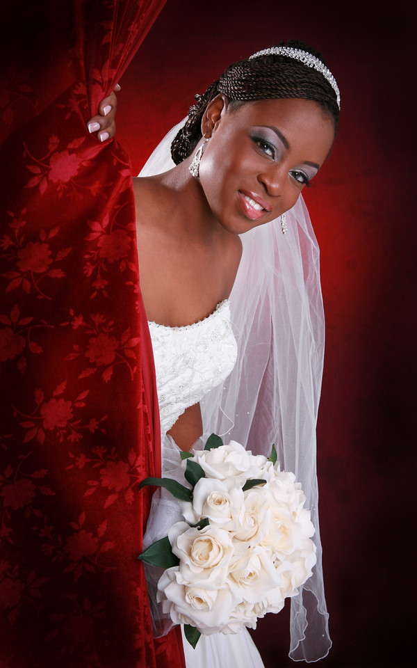 Beautiful Young Bride Open Curtain Portrait on Red Background