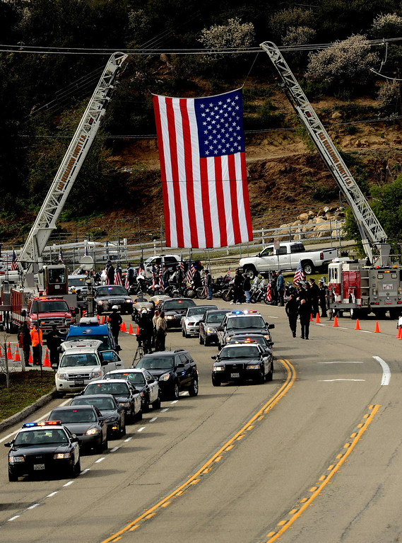 . The procession for San Bernardino County Sheriff Deputy Jeremiah MacKay travels along Glen Helen Parkway on its way to the San Manuel Amphitheater in Devore February 21, 2013.  The procession was 13-miles long and stretched from San Bernardino, to Fontana, to Devore.  GABRIEL LUIS ACOSTA/STAFF PHOTOGRAPHER.