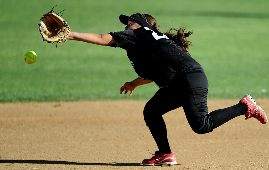 . Corona Centennial second baseman Anna Ontneros can\'t reach a base hit by Bonita\'s Veronica Ortega (not pictured) in the fourth inning of Charter Oak softball Tournament semifinal softball game at the Big League Field of Dreams Park on Friday, March 15, 2013 in West Covina, Calif. Corona Centennial won 5-1.  (Keith Birmingham Pasadena Star-News)