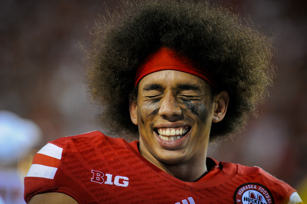 . LINCOLN, NE - SEPTEMBER 7: Wide receiver Kenny Bell #80 of the Nebraska Cornhuskers laughs with teammates on the sidelines during their game against the Southern Miss Golden Eagles at Memorial Stadium on September 7, 2013 in Lincoln, Nebraska. Nebraska defeated Southern Miss 56-13. (Photo by Eric Francis/Getty Images)