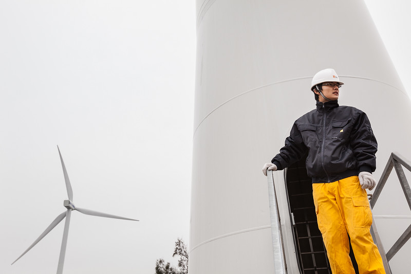 A China Resources New Energy Group Co., Ltd. employee stands on a wind turbine maintenance platform in Shantou, Guangdong Province, China on Friday, Jan. 21, 2011. Photographer: Forbes Conrad/Bloomberg News