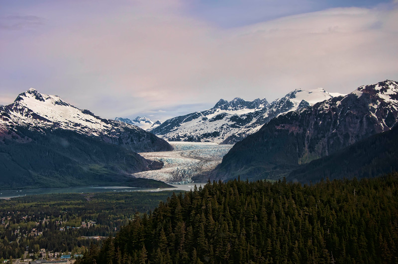 The tip of Mendenhall Glacier is seen here at a distance as we flew towards it through the mountains.