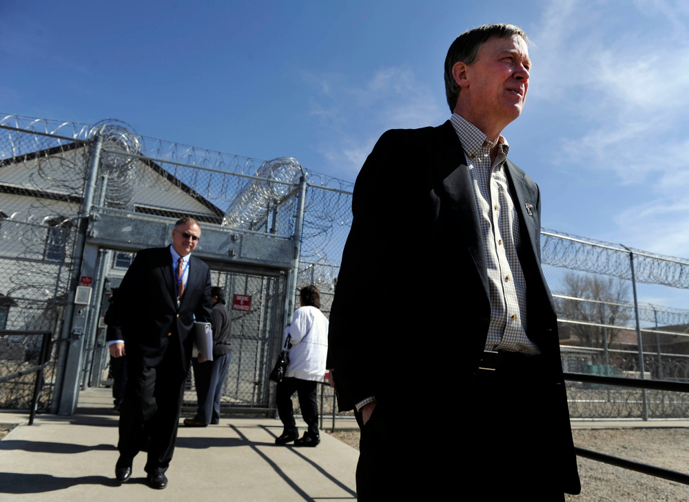. (File Photo) LAS ANIMAS, CO--Colorado Governor, John Hickenlooper, right, exits the Fort Lyon Correctional Facility in Las Animas Colorado Wednesday afternoon after taking a tour. Tom Clements, Executive Director of Department of Corrections, left, follows. Andy Cross, The Denver Post