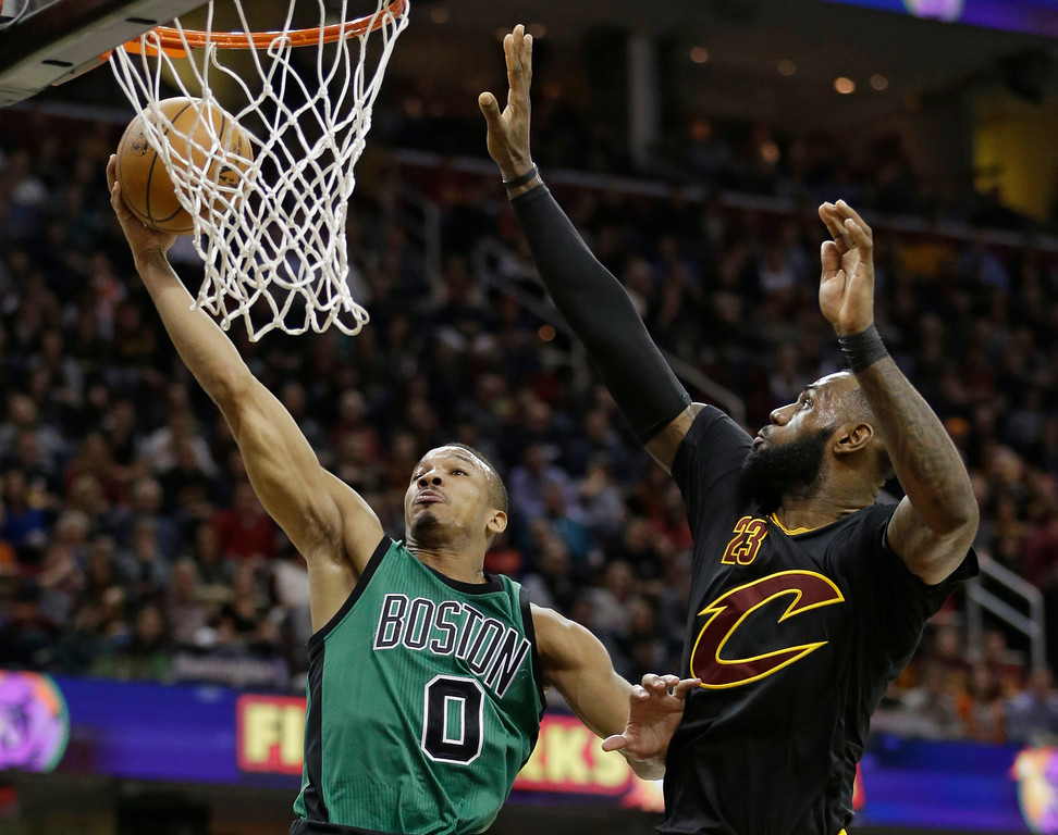. Boston Celtics\' Avery Bradley (0) drives to the basket against Cleveland Cavaliers\' LeBron James (23) in the first half of an NBA basketball game, Thursday, Dec. 29, 2016, in Cleveland. (AP Photo/Tony Dejak)