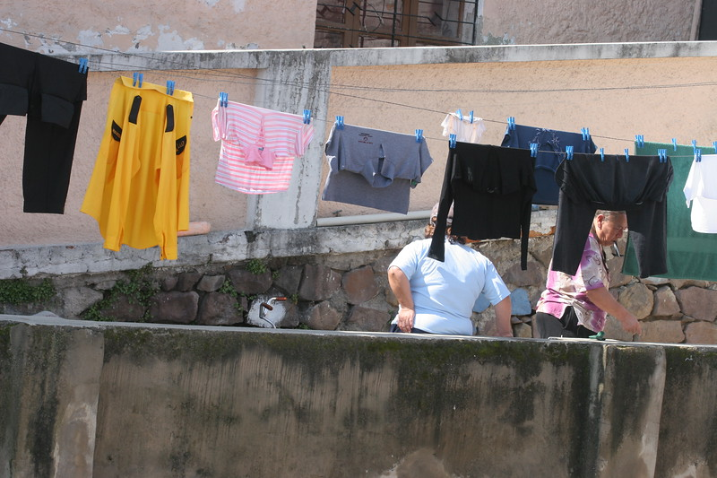 Women doing laundry across the street do what most do in Ecuador... hang it on a line to dry.  To this gringo it seemed kind of eye-catching at first.  After considering it a little I realized that although it might take a little longer to dry clothes this way it really is the best way.