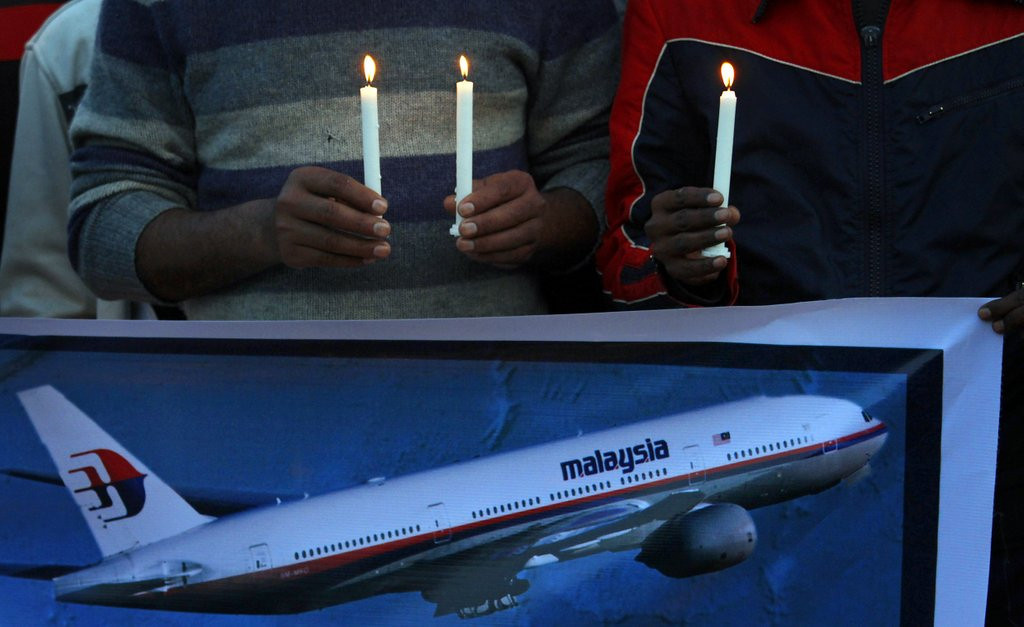 """. <p>4. MALAYSIAN AIRLINES FLIGHT 370  <p>If plane is found, weeping from families will be exceeded only by the weeping from CNN. (unranked) <p><b><a href=\'http://www.cnn.com/2014/03/20/world/asia/malaysia-missing-what-next/\' target=\""""_blank\""""> HUH?</a></b> <p>    (AP Photo/Anjum Naveed)"""