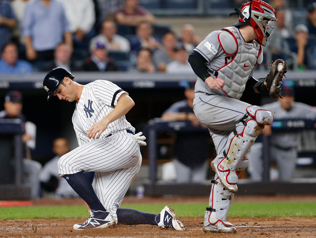 . Cleveland Indians catcher Roberto Perez tags home plate for the force out on New York Yankees\' Greg Bird during the third inning in Game 4 of baseball\'s American League Division Series, Monday, Oct. 9, 2017, in New York. (AP Photo/Kathy Willens)