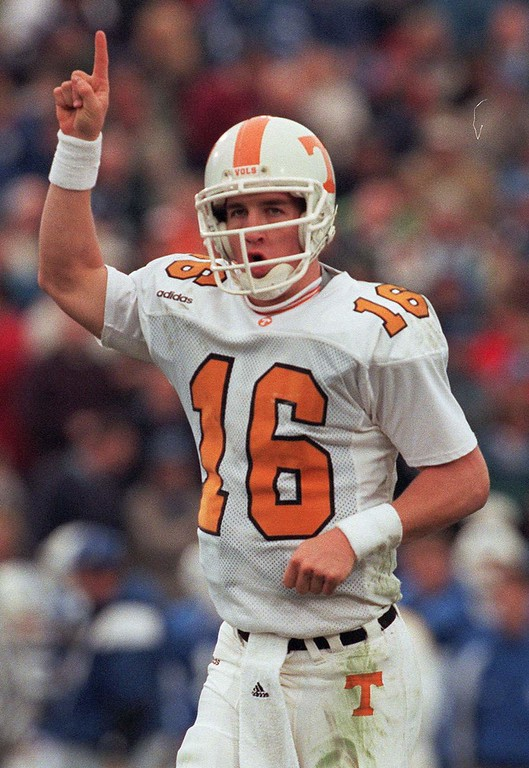 . Tennessee quarterback Peyton Manning (16) celebrates a first half touchdown during Saturday\'s game. The Volunteers rolled up a season-high 695 yards while beating Kentucky 59-31. Manning threw for 5 touchdowns.