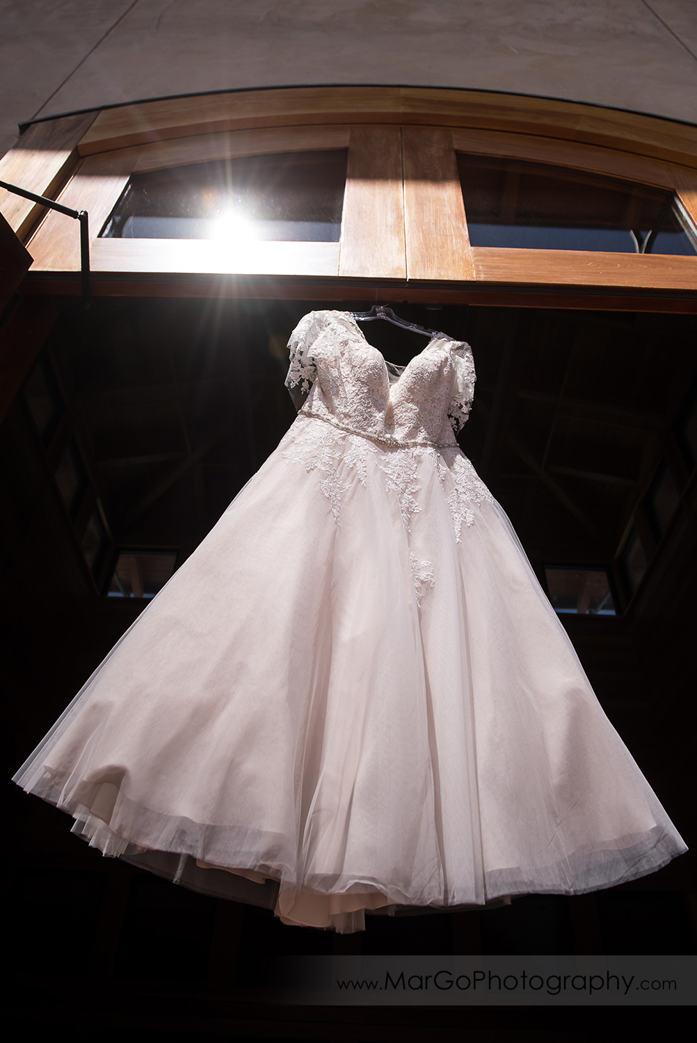 wedding dress hanging in the doorway at Livermore Garre Vineyard and Winery