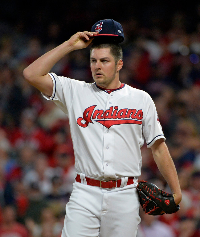 . Cleveland Indians starting pitcher Trevor Bauer adjusts his cap in the second inning of Game 1 of baseball\'s American League Division Series against the New York Yankees, Thursday, Oct. 5, 2017, in Cleveland. (AP Photo/Phil Long)