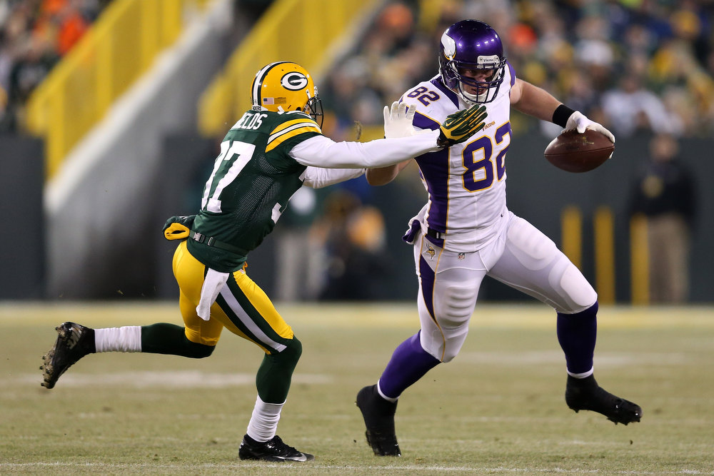 Description of . Tight end Kyle Rudolph #82 of the Minnesota Vikings runs after a catch against cornerback Sam Shields #37 of the Green Bay Packers in the first half during the NFC Wild Card Playoff game at Lambeau Field on January 5, 2013 in Green Bay, Wisconsin.  (Photo by Andy Lyons/Getty Images)