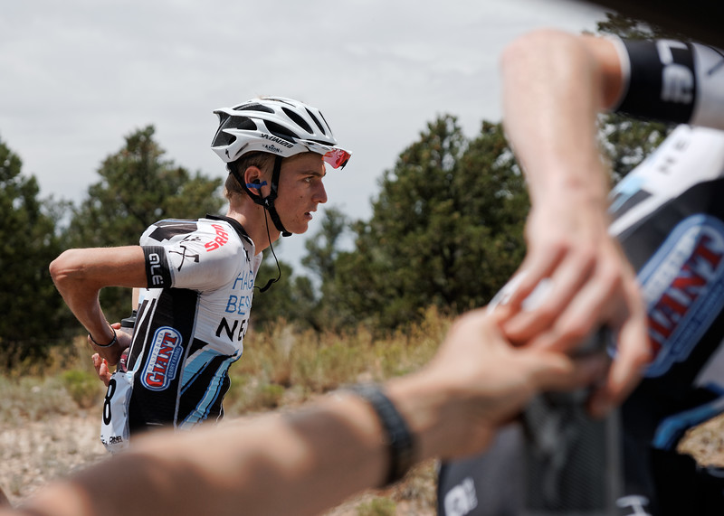 """Somewhere between Escalante & Torrey, riders used ice packs to stay cool & fresh bottles to hydrate in the scorching desert heat, Larry H. Miller @TheTourofUtah, Stage 2.  """"I think it was over 100⁰ that day, but the team still gave a strong showing,"""" Davey Wilson recalls, """"I really gotta hand it to team sponsor, @KleanAthlete. Their Electrolytes supplement is a lifesaver on days like these."""" #PROVEIT #tourofutah   (📷: Copyright © @DaveyWilson)"""