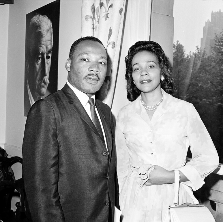 . Civil rights leader Dr. Martin Luther King Jr. is accompanied by his wife Coretta at New York\'s International Airport, on December 4, 1964. The reverend is en route to Oslo to receive the Nobel Peace Prize awarded to him.  (AP Photo)