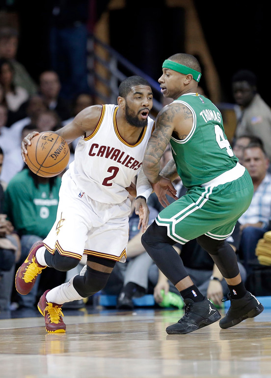 . Cleveland Cavaliers\' Kyrie Irving (2) drives past Boston Celtics� Isaiah Thomas (4) in the first quarter of a first-round NBA playoff basketball game Tuesday, April 21, 2015, in Cleveland. (AP Photo/Mark Duncan)