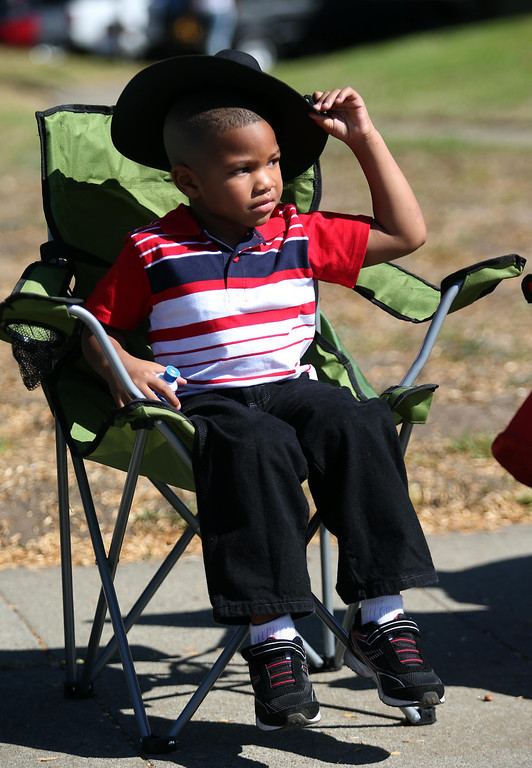 . Keyontae Littlepage, 4, of Sacramento, adjusts his hat as he watches along 18th Street during the 39th annual Oakland Black Cowboy Parade and Heritage Festival in Oakland, Calif., on Saturday, Oct. 5, 2013. The event also featured food, entertainment and pony rides for kids at De Fremery Park. The Oakland Black Cowboy Association began in 1975 and educates the public about the role that black cowboys played in history and building of the west. (Jane Tyska//Bay Area News Group)