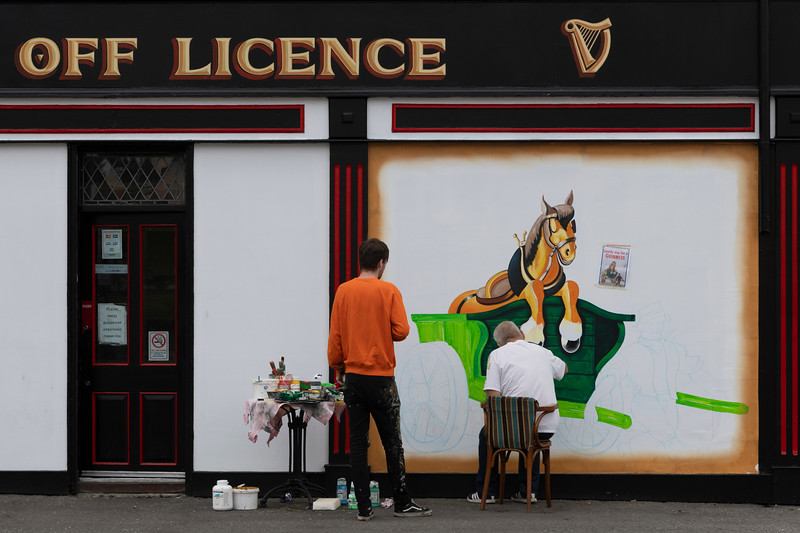 Artists painting a picture on a wall, Free Derry, Londonderry, Northern Ireland, United Kingdom