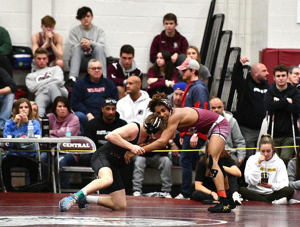 2/22/2020 Mike Orazzi | StaffrBristol Central's Karriem Hoe and Pomperaug's Michael Carpenter in a 126 match during the Class L State Wrestling Tournament held at Bristol Central High School on Saturday.